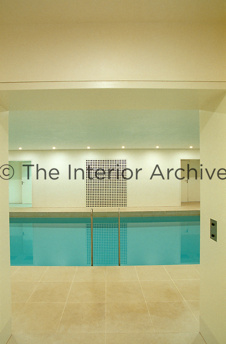 The indoor swimming pool of architect Oswald Mathias Ungers' house where a pair of doors is arranged in perfect symmetry on either side of a latticework grille