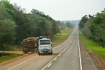 A logging truck turns onto the highway in the province of Misiones, Argentina.  Much of the land here that once belonged to the Mbya Guarani has been purchased by foreign logging and agricultural companies.