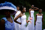 Yolissa Koza, a consultant for an international management consulting firm, with her sister and brides maids after she got married on April 19, 2003 at an exclusive lodge in Muldersdrift outside Johannesburg, South Africa. Yolissa and her husband Sandile, belong to the new black elite in the country. The couple, educated and connected, has successful careers and has money to spend on luxury items and western influenced lifestyle. They invited five hundred guests to the western styled wedding. (Photo by: Per-Anders Pettersson)