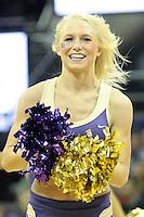 December 29, 2013:  Washington cheerleader Jenna Donohue entertained fans during the game against Hartford.  Washington defeated Hartford 73-67 at Alaska Airlines Arena in Seattle, Washington.