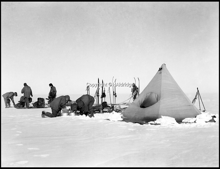 BNPS.co.uk (01202 558833)<br /> Pic: HAldridge/BNPS<br /> <br /> Scott's team preparing to depart.<br /> <br /> Poignant unseen photographs taken by Lt Bowers of Scott's ill-fated 1912 Antarctic expedition have come to light. <br /> <br /> Bowers perished with Scott on their return from the South Pole, but these photographs taken by him were returned to Britain with expedition photographer Herbert Ponting.<br /> <br /> They show the team with their dogs and ponies on the Ross Ice Shelf preparing for their doomed departure for the Pole.