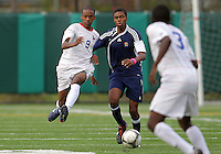 HYATTSVILLE, MD - OCTOBER 26, 2012:  Michael McCoy (9) of DeMatha Catholic High School moves up on Azaan Wilbon (15) of St. Albans during a match at Heurich Field in Hyattsville, MD. on October 26. DeMatha won 2-0.