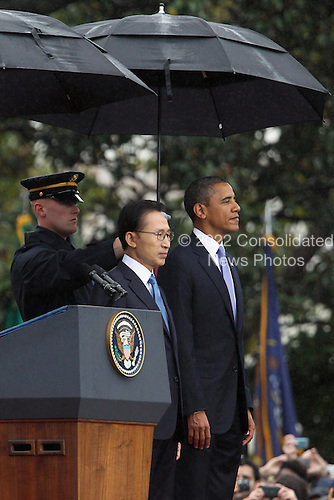 President Lee Myung-bak (L) of the Republic of Korea is welcomed to the White House by United States President Barack Obama (R) during an arrival ceremony, Thursday, October 13, 2011 in Washington, DC. Later in the day Lee is scheduled to hold a joint press conference with Obama and also address a joint meeting of Congress.  .Credit: Alex Wong / Pool via CNP