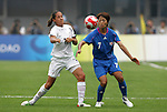 06 August 2008: Kozue Ando (JPN) (7) plays the ball in front of Marlies Oostdam (NZL) (17).  The women's Olympic team of New Zealand tied the women's Olympic soccer team of Japan 2-2 at Qinhuangdao Olympic Center Stadium in Qinhuangdao, China in a Group G round-robin match in the Women's Olympic Football competition.