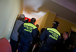 Police coming to evict Ecuadorian homeowners Kelly Herrera and Nelson Castillo stand on March 13, 2012 in their house in Madrid. Spain on March 9 approved a new voluntary 'code of conduct' for banks which aims to help poor homeowners settle their debts and reduce a wave of evictions brought on by the economic crisis. Spanish banks currently seize the homes of those who default on their mortgages and often demand further payment from those evicted if the value of the house has fallen below that of the loan. The new rules will apply in cases where every member of a household is unemployed and mortgage payments are equal to more than 60 percent of their income.(c) Pedro ARMESTRE