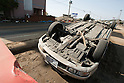 Mar. 13, 2011 - Kita-Ibaraki Japan - A vehicle is shown flipped over on the road two days after the 8.9 magnitude earthquake struck followed by a tsunami that hit the north-eastern region. The death toll is currently unknown with casualties that may run well into the thousands.
