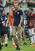 USA coach Juergen Klinsmann smiles as he leaves the field at full time