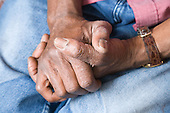 Elderly man's clasped hands. MR