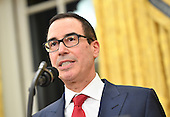 United States Secretary of the Treasury Steven Munchin delivers remarks during his swearing-in ceremony at the White House in Washington, D.C. on February 13, 2017. Mnuchin was confirmed by the Senate 54-47 earlier today. <br /> Credit: Kevin Dietsch / Pool via CNP