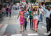 Indian-Americans from the tri-state area around New York celebrate at the Indian Independence Day Parade on Madison Ave. on Sunday, August 18, 2013.  Now in it's 33rd year, the parade celebrates the 66th anniversary of India's partition from British rule on August 15, 1947. (© Richard B. Levine)