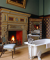 This grand bathroom has 19th century hand-painted walls restored by Donald Smith and the bath was found in the cellar