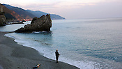 Fisherman on the beach, Monterosso al Mare, Italy.