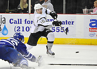San Antonio Rampage right wing Bobby Butler shoots past Toronto Marlies defenseman Kevin Marshall during an AHL hockey game, Sunday, Nov. 24, 2013, in San Antonio. (Darren Abate/AHL)