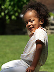 Cute smiling three year old girl summertime outdoor portrait