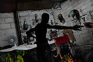 A Cuban man prepares the Palo religious ritual in the home temple in Santiago de Cuba, Cuba, August 1, 2009. The Palo religion (Las Reglas de Congo) belongs to the group of syncretic religions which developed in Cuba amongst the black slaves, originally brought from Congo during the colonial period. Palo, having its roots in spiritual concepts of the indigenous people in Africa, worships the spirits and natural powers but can often give them faces and names known from the Christian dogma. Although there have been strong religious restrictions during the decades of the Cuban Revolution, the majority of Cubans still consult their problems with practitioners of some Afro Cuban religion.