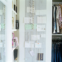 In the dressing room panels upholstered in pale grey linen are used as a pinboard for correspondence and to display jewellery