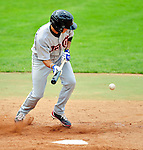 25 July 2010: Tri-City ValleyCats infielder Oscar Figueroa lays down a bunt against the Vermont Lake Monsters at Centennial Field in Burlington, Vermont. The ValleyCats came from behind to defeat the Lake Monsters 10-8 in NY Penn League action. Mandatory Credit: Ed Wolfstein Photo