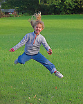 young girl jumping with enthusiasm