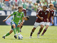 Seattle Sounders FC midfielder Osvaldo Alonso, left, looks to pass against Colorado Rapids midfielder Pablo Mastroeni during play at CenturyLink Field in Seattle Saturday July 17, 2011. The Sounders won the game 4-3.