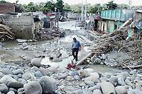 Man trying to navigate his way through the debris left after huricane Stan.  Miguel de la Madrid neighbourhood, Tapachula Chiapas.