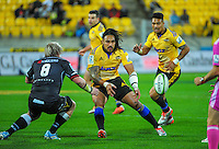 Ma'a Nonu passes to Matt Proctor during the Super Rugby match between the Hurricanes and Sharks at Westpac Stadium, Wellington, New Zealand on Saturday, 9 May 2015. Photo: Dave Lintott / lintottphoto.co.nz