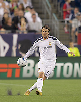 Los Angeles Galaxy midfielder David Beckham (23) passes the ball. In a Major League Soccer (MLS) match, the Los Angeles Galaxy defeated the New England Revolution, 1-0, at Gillette Stadium on May 28, 2011.