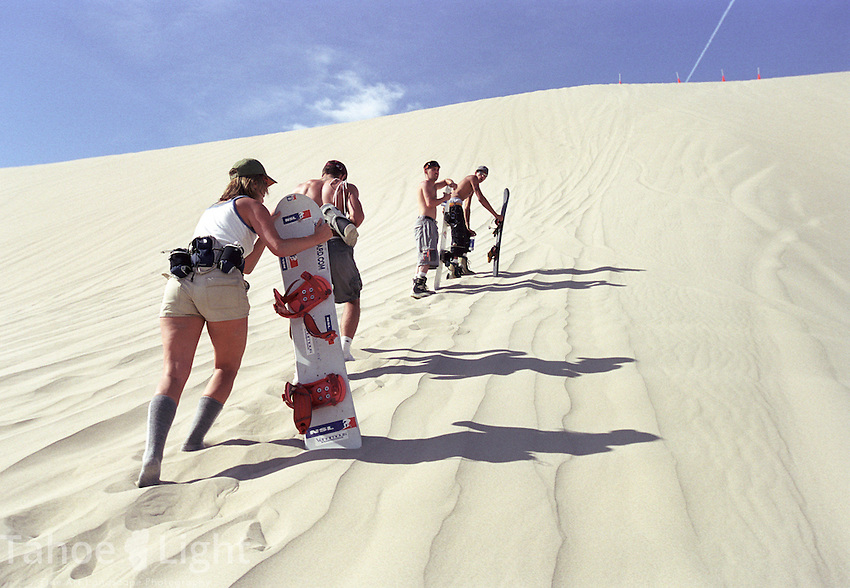 andboarders make their way up Sand Mountain during the huckfest big air competition Sept 14.