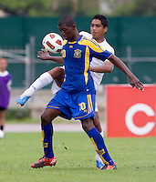 Joshua Nieto (19) of Honduras clears the ball away from Diquan Adamson (10) of Barbados during the group stage of the CONCACAF Men's Under 17 Championship at Catherine Hall Stadium in Montego Bay, Jamaica. Honduras defeated Barbados, 2-1.