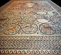 Roman mosaic of an early Christian church floor from Qabr Hiram, Lebanon, 575 AD. Marble blocks and glass paste cubes. This mosaic was designed to follow the layout of the church which had three naves. It depicts God through images of his creation: rural activities, fruit, animals with representations of the months, seasons and winds. The inscription indicates that the basilica was dedicated to St. Christopher and was built in 575 AD.. Inv 32230-2236, Louvre Museum, Paris