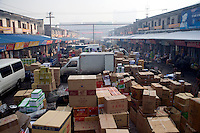Shipments await delivery or unpacking in a busy market in Urumqi, Xinjiang, China.