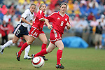 Diana Matheson (8) and Amanda Cicchini (14) of Canada and Kristine Lilly (13) of the United States on Sunday June 26th, 2005, during an international friendly soccer match at Virginia Beach Sportsplex in Virginia Beach, Virginia. The United States won the game 2-0.