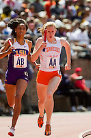 West Catholic grad, Latavia Thomas (LSU) hangs on with Phoebe Wright of Tennessee during the anchor leg of the College Women's 4x800 Championship of America. Thomas gave Wright a run for her money, but LSU took second place in 8:19.77.