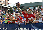 Kids clamor for balls at the 2010 South Atlantic League All-Star Game on Tuesday, June 22, 2010, at Fluor Field at the West End in Greenville, S.C. Photo by: Tom Priddy/Four Seam Images