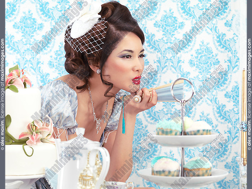 Young asian woman  with a beautiful hair style and makeup at a tea party table