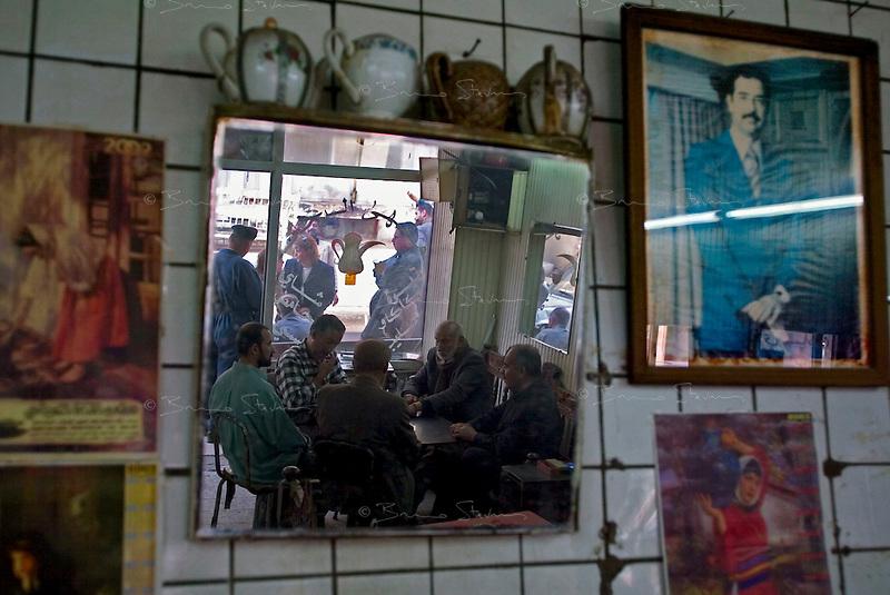 Baghdad, Iraq, April 3, 2003.Baghdad inhabitants playing Taoli (dominoes) in a Saadoun street cafe during a US air raid.