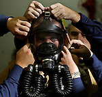 Seaman Recruit Shaun Conklin is assisted by fellow recruits from his company during Boot camp at The United States Coast Guard Training Center Cape May, NJ.