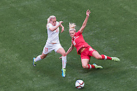 June 21, 2015: Lara DICKENMANN of Switzerland and Lauren SESSELMANN of Canada compete for the ball during a round of 16 match between Canada and Switzerland at the FIFA Women's World Cup Canada 2015 at BC Place Stadium on 21 June 2015 in Vancouver, Canada. Canada won 1-0. Sydney Low/Asteriskimages.com