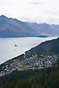 View from ski run of City center area of Queenstown, South Island, New Zealand.  This is a popular snow skiing area and summer resort for vacationers.  Also popular for other adventure sports such as parasailing and bungy jumping.