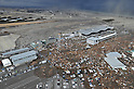 The Aftermath of the Massive M8.9 Earthquake and Tsunami Around Sendai Airport at 4pm on March 11th 2011. Fires Also Visible