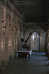 Asia, India, Uttar Pradesh, Fatehpur Sikri. A man plays a sitar in the halls of Fatehpur Sikri.