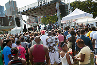 """Visitors to the AfroPunk Festival in Commodore Barry Park in Brooklyn in New York on Sunday, August 26, 2012. The festival in the neighborhood of Fort Greene bills itself as the """"other black experience"""" and blends the black punk and hardcore punk scenes. There is also a diverse aspect combining other minority groups, all dressed in their fashionable punk ensembles. (© Richard B. Levine)"""