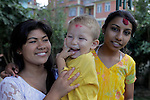 Asia, Nepal, Kathmandu. Nepali sisters and baby brother.