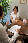 """Etsuko Satake (l) critiques a simulation class between student """"Keiko"""" (r) and an unidentified coach (not pictured) at Infini, a school training marriage hopefuls how to hook Mr. or Mrs. Right in Tokyo, Japan on Sep. 9, 2010."""
