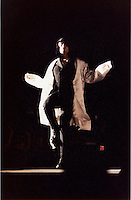 25 April 1997:  U2 lead singer BONO skipping an imaginary rope down the runway wearing a white hooded jacket and sunglasses entering the stadium during the U2 PopMart Tour in Las Vegas.  Photo &copy;1997ShellyCastellano.com  Print Scan. Roll / Negative # 3/6