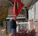 11/7/07 Smith Center, KS.Paul Pletcher with a flag showing his support of the Smith Center Redmen football team..Pletcher has two grandson's on the team Cody  and Van Tucker..(Chris Machian/Prairie Pixel Group)