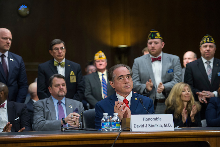 UNITED STATES - FEBRUARY 01: David Shulkin, nominee for Veterans Affairs secretary, applauds as veterans are recognized during his Senate Veterans' Affairs Committee confirmation hearing in Dirksen Building, February 1, 2017. (Photo By Tom Williams/CQ Roll Call)