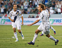CARSON, CA - June 23, 2012: LA Galaxy forward Landon Donovan (10) and midfielder Mike Magee (18) during the LA Galaxy vs Vancouver Whitecaps FC match at the Home Depot Center in Carson, California. Final score LA Galaxy 3, Vancouver Whitecaps FC 0.