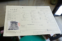 A Kobe beef certificate showing the cow's unique nose-print and three generations of progenitors. Maruse Stockbreeding Inc, Hyogo Prefecture, Japan, June 25, 2009.