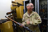 Baghdad, Iraq, June 5, 2003.Master Sargent Cortolesso is the enthusiast weapon expert of his unit; as such he is responsable for listing, describing and finally disposing all the weapons cofiscated by US troops in the Northern part of Baghdad. Most weapons originate from the eastern block: Russia, China, Yougoslavia...some are older such as this 1943 British Enfield rifle..