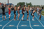 The anchor legs of the 4x400 meter relay teams waiting for their turn during the 4A Idaho  Track and Field Championships on May 19, 2012 at Middleton High School, Middleton, Idaho.